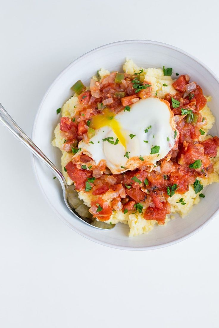 This fun Mediterranean dish by is friendly for vegetarians and meat-eaters alike. Eggs are cooked in a tangy tomato sauce, and served with crisp veggies.