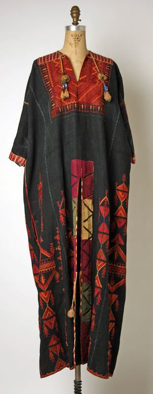 Palestinian dress Hebron الخليل. Slit up the front is only attached at the him with reverse appliqué on either side. Aida Dalati