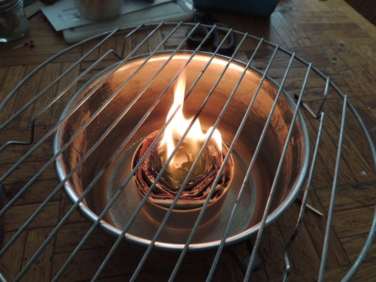 """How to make a tuna can stove/""""survival candle"""" using an empty tuna can, old wax candles and cardboard. She also shows you how to use it as a stove and gives you some good tips"""