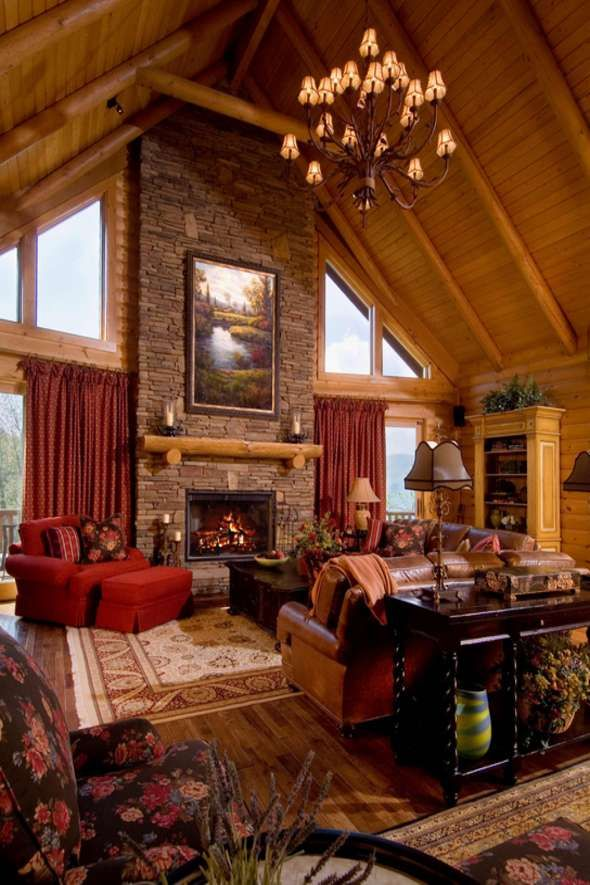 A grand fireplace makes a spectacular statement in this custom log home.  The views beyond are of the beautiful North Carolina mountains.