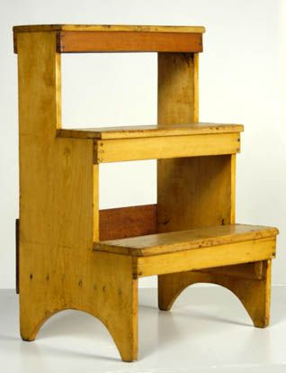 "Three-step stool, pine, original yellow stained varnish finish, Sister's steps for large cupboards and chests, arched sides, New Lebanon, NY, c. 1850, signed underneath ""To Carman and George Davis, 1974 from the Belfit Collection"", 23 1/2"" h, 15 1/2"" w, 12 1/2"" d"