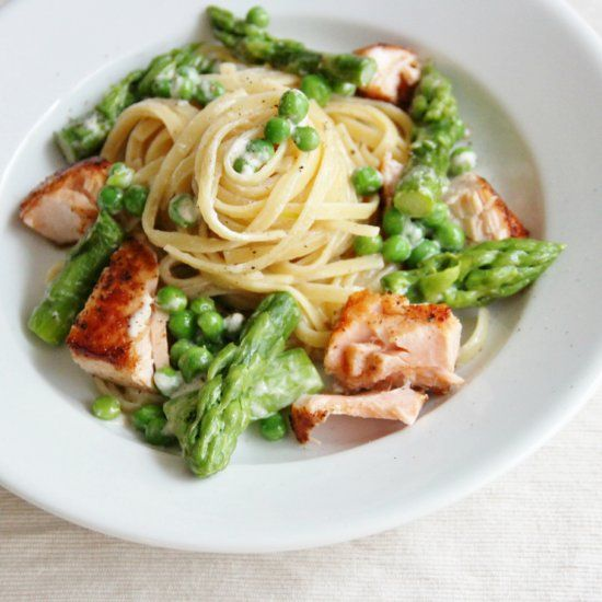 Pasta with a lightened tarragon cream sauce and salmon, asparagus & peas