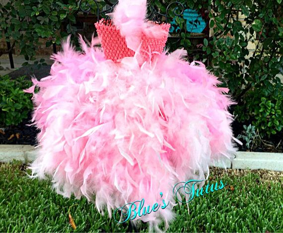 This tutu dress is tea to full length and comes with 2 rows of pink and black tulle underneath. Feather are soft and high quality. Perfect for parties, dress up, costume parties and more! The tulle is knotted in the crochet top and the feather boas are sewn in.