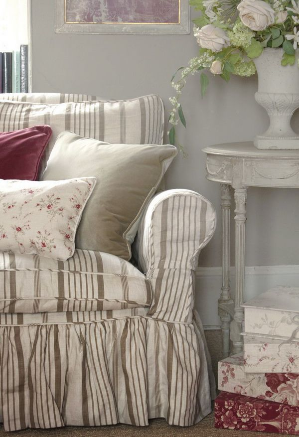 Pretty slipcover--Stripes and florals, white table.