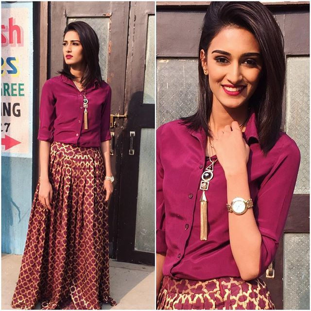 Sonakshi's lookbook ( P.S these outfits are customized n are not from any specific brand ) Wine shirt n wine brocade skirt   Teamed up with a long chain (@flauntnflair) and a watch