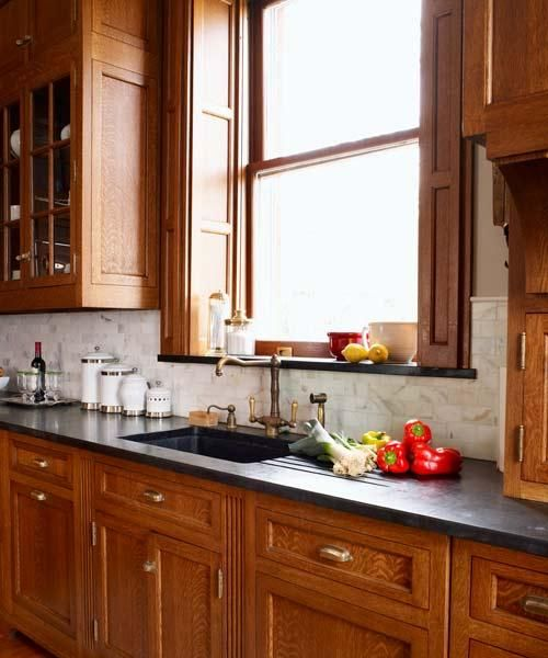 This soapstone countertop has an integrated sink and drainboard and a matching windowsill. | Photo: Alexandra Rowley | thisoldhouse.com