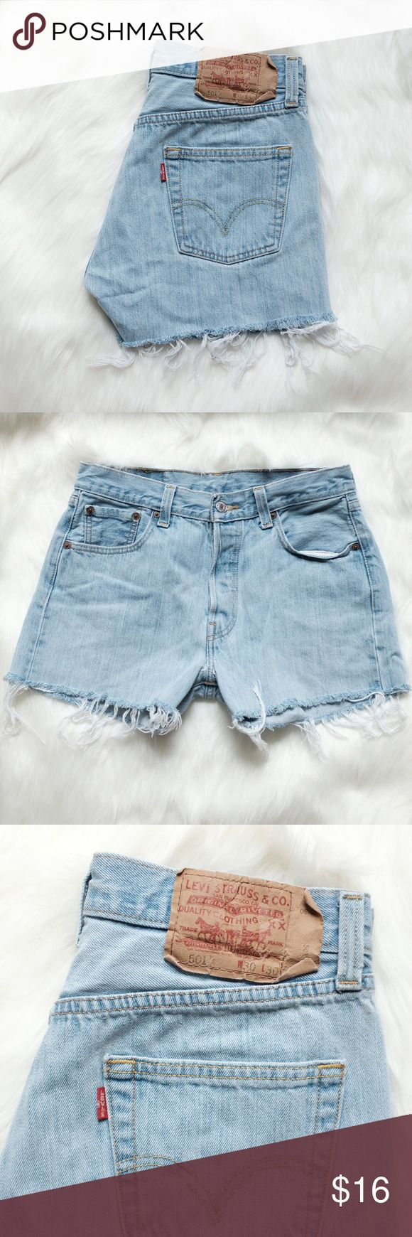 """Vintage Levi's 501s denim cut-offs Vintage lightwash Levi's 501s from my personal stash. I'm selling cheap. Please look at my other new listings because sizing is similar and you can bundle to save on total price and shipping! #vintage #levis #501s #retro #distressed  Fits a 27"""" waist best Inseam is 3""""  **Good condition except for small hole near crotch (can be seen on left side in second photo)** Levi's Shorts Jean Shorts"""
