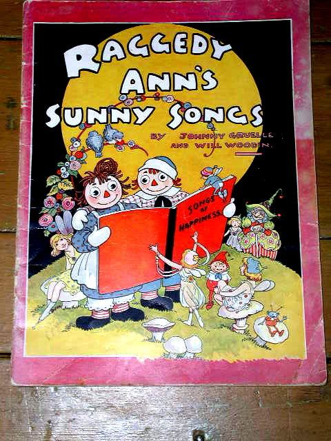 Raggedy Ann's Sunny Songs,  a 1930 First Printing of this song book with music by Will Woodin and words and drawings by Johnny Gruelle.   A rare soft cover book in very good condition. Priced at $210.00.