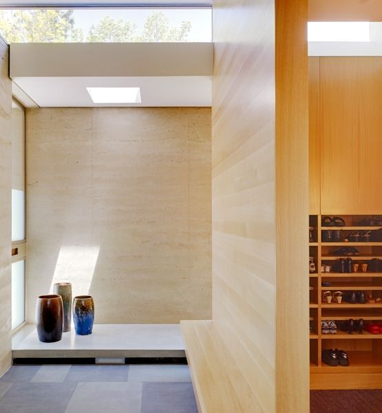 """I've always wanted a """"mudroom"""". I like the step up & place for shoes at the entry. Modeled after a Genkan entry, a feature of Japanese houses, this minimalist mudroom in Palo Alto, Calif., features exterior stone paving that continues into the home. CCS Architecture crafted the interior floor to be raised by 6 inches, where guests then walk with their shoes off."""
