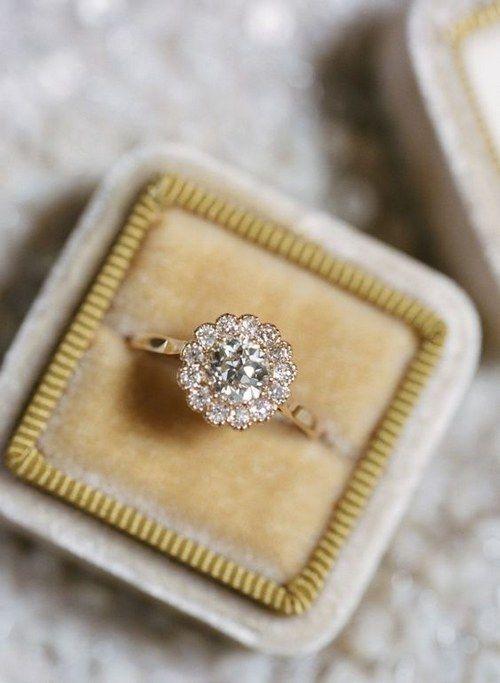 diamond halo engagement ring via Elisa Bricker / http://www.deerpearlflowers.com/floral-inspired-engagement-rings/