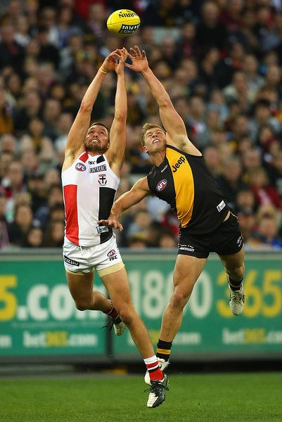 Jarryn Geary of the Saints and Matthew Arnot of the Tigers contest for a mark during the round 14 AFL match between the Richmond Tigers and the St Kilda Saints at Melbourne Cricket Ground on June 30, 2013 in Melbourne, Australia. (Photo by Quinn Rooney/Getty Images)