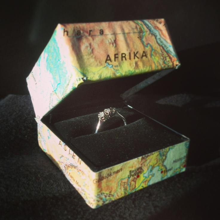 Wedding ring with diamonds. In box with map decopage.