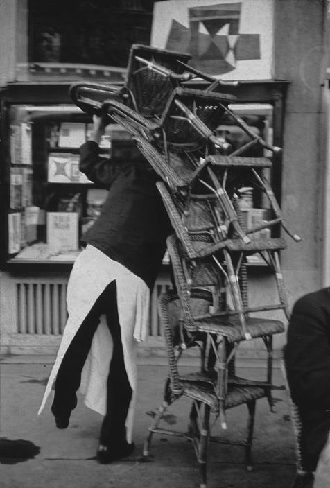 Parfois, on en a plein l'dos ! / Au café Flore, Paris, France. / Photo by Henri Cartier-Bresson, 1959.