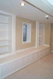 Built in basement storage---need to make so the benches open for toy/blanket storage.
