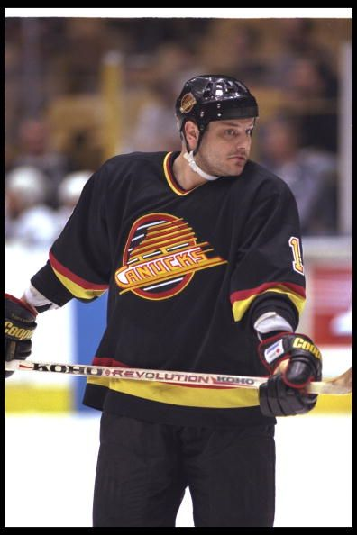 Leftwinger Esa Tikkanen of the Vancouver Canucks looks on during a game against the Los Angeles Kings at the Great Western Forum in Inglewood...