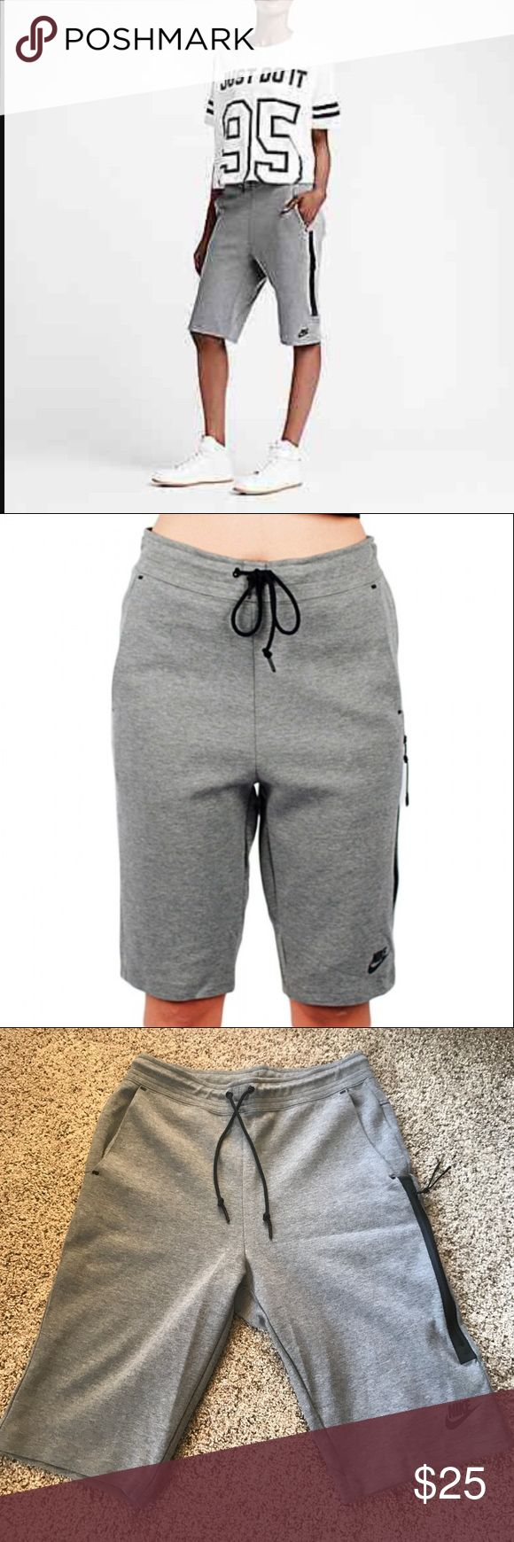 Nike women tech fleece short M gray NWOT PREMIUM COMFORT The Nike Tech Fleece Women's Shorts are made with a soft cotton blend and an oversized, bonded zip pocket for a comfortable fit and convenient storage. BENEFITS Front bonded zip pocket and side pockets Inseam gusset provides wide range of motion PRODUCT DETAILS Elastic waist with exterior drawcord Fabric: Body: 69% cotton/31% polyester. Pocket bags: 100% cotton.  Machine wash Imported  M Nike Shorts