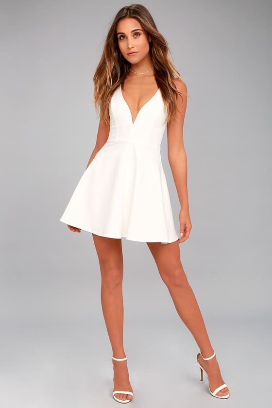 There is so much to adore with the Love Galore White Skater Dress! This thick stretch knit dress has a fitted bodice with princess seams, a deep V-neckline (with hidden V bar), plus a flirty skater skirt. Double straps and hidden zipper at back.
