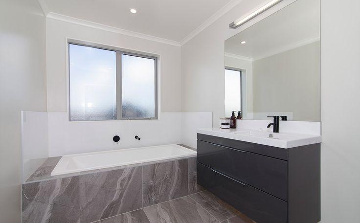 This bathroom includes a built in bathtub.