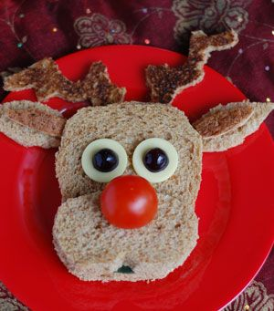 #food Reindeer  The best bit about this sandwich is the use of toasted bread for the antlers, it gives a nice dark texture and works well.    Ingredients  brown bread  sandwich filling  cherry tomato  cheese  black grapes  cucumber  How to make it: check link