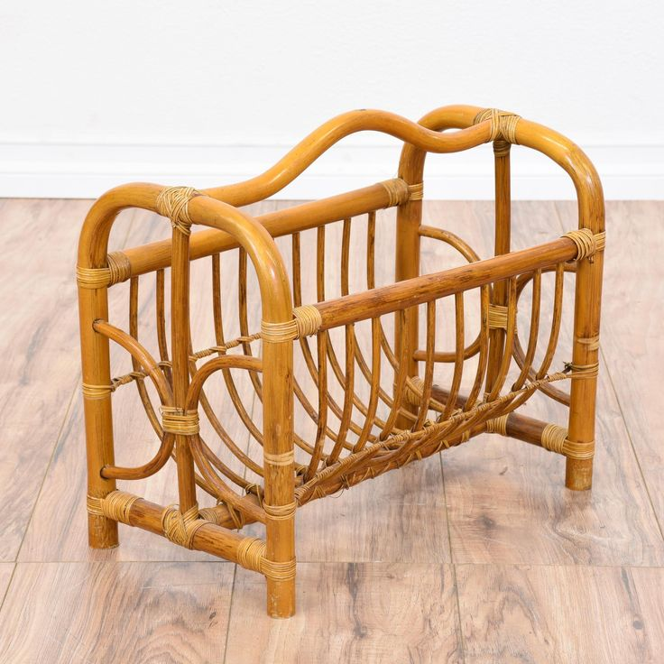 This tropical magazine rack is featured in a bentwood rattan with a light glossy teak finish. This book holder is in great condition with a curved cubby perfect for magazines and a handle for easy mobility. Beach chic magazine rack perfect for knitting supplies! #tropical #storage #magazinerack #sandiegovintage #vintagefurniture