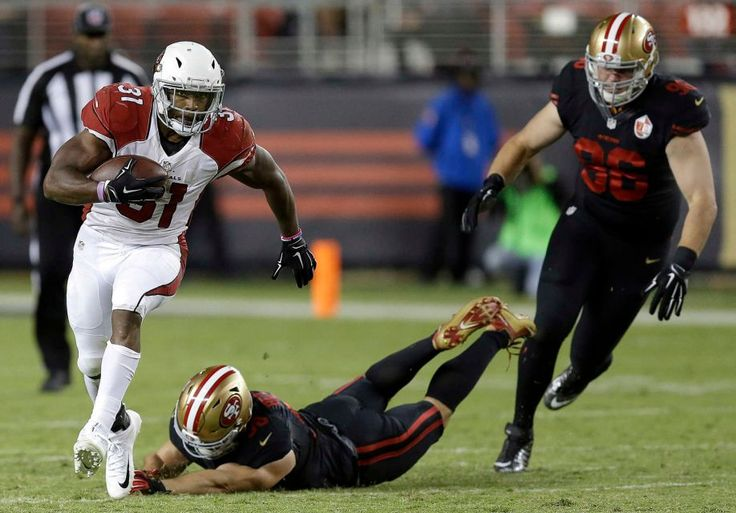Thursday Night Football: Cardinals vs. 49ers  -  October 6, 2016:  33 - 21, Cardinals  -    Arizona Cardinals running back David Johnson (31) runs from San Francisco 49ers linebacker Nick Bellore, middle, and defensive end Taylor Hart (96) during the second half of an NFL football game in Santa Clara, Calif., Thursday, Oct. 6, 2016.