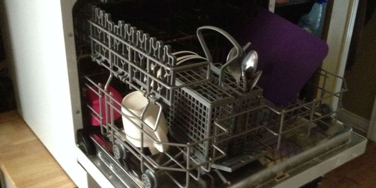 """How We Handle Laundry and Dishes in Our 250-Square-Foot Home. One of the first things I asked our landlords was, """"Is there a Laundromat nearby, or do we have to beat our clothes on a rock down by the nearest creek like the pioneers did?"""""""