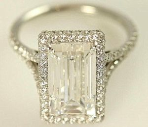 GIA certified 5 carat Emerald Cut Diamond by BeautifulPetra. This is gorgeous and has a big stone, just like one I used to own. Sold it to buy a bigger stone.