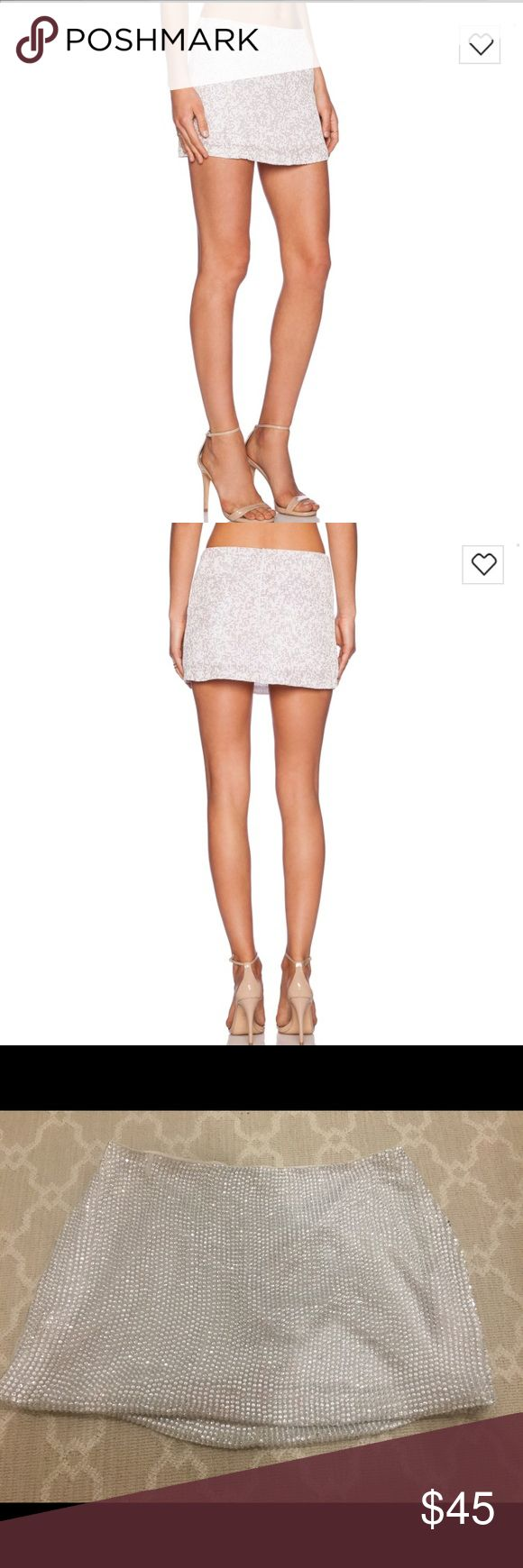 WORN ONCE! MLV Bonnie Sequin Skirt in Ivory - M Worn once for my Bachelorette! Bought for $239 on Revolve. MLV (Mayren Lee Viray) sequin mini skirt in Ivory - size medium. Great condition. So fun and flirty! See photos for item details. Size Medium - fits like a 4. MLV Skirts Mini