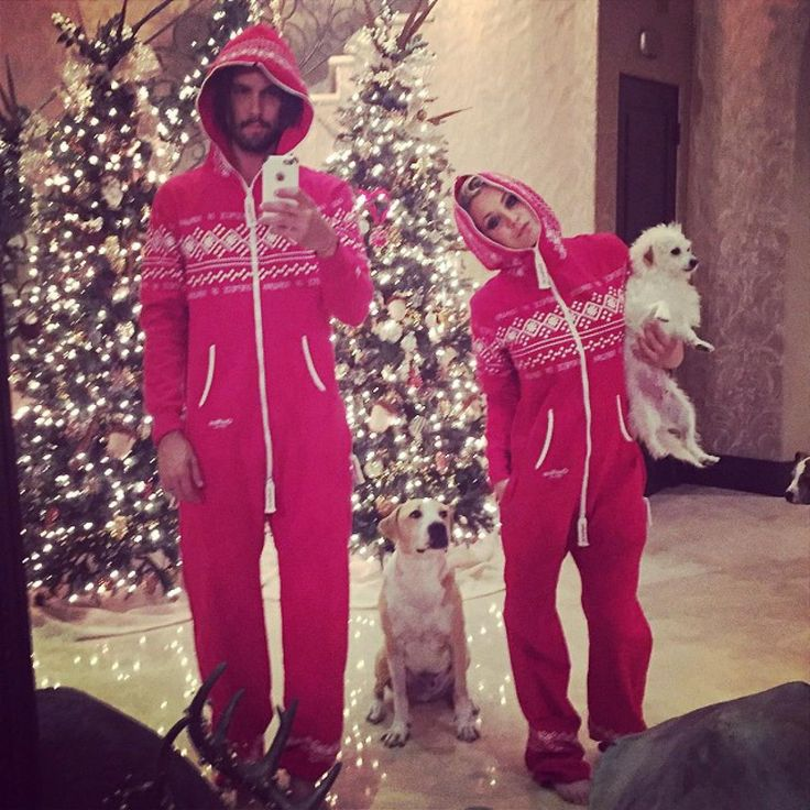 """Seeing double! Actress Kaley Cuoco-Sweeting and husband Ryan Sweeting dressed up in matching pajamas to pose for this Instagram snap with their adorable pups. """"This is what the Sweetings do after a night at an award show. End up in matching onesies surrounded by dogs,"""" she captioned the photo after attending the People Magazine Awards on Dec. 18, 2014."""