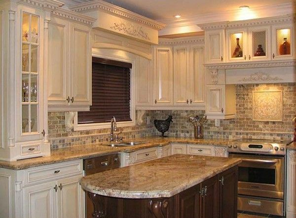 Old world style kitchen love the detailed carved off for White kitchen cabinets what color backsplash