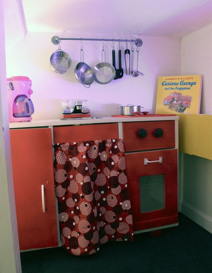 Play kitchen in closet under the staircase! I would have never come out
