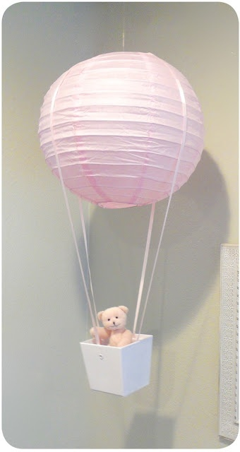 Using a lantern as a hot air balloon. Could work as a shower decoration and then be incorporated into the nursery