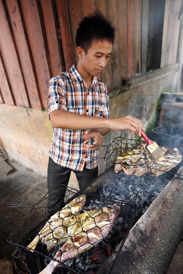 """Grilled fish, or """"Ikan bakar"""" is wildly popular on weekends in places like Tureloto or Asi Walo in North Nias Regency, Nias Island, Indonesia.  Photo by Bjorn Svensson. www.northniastourism.com"""