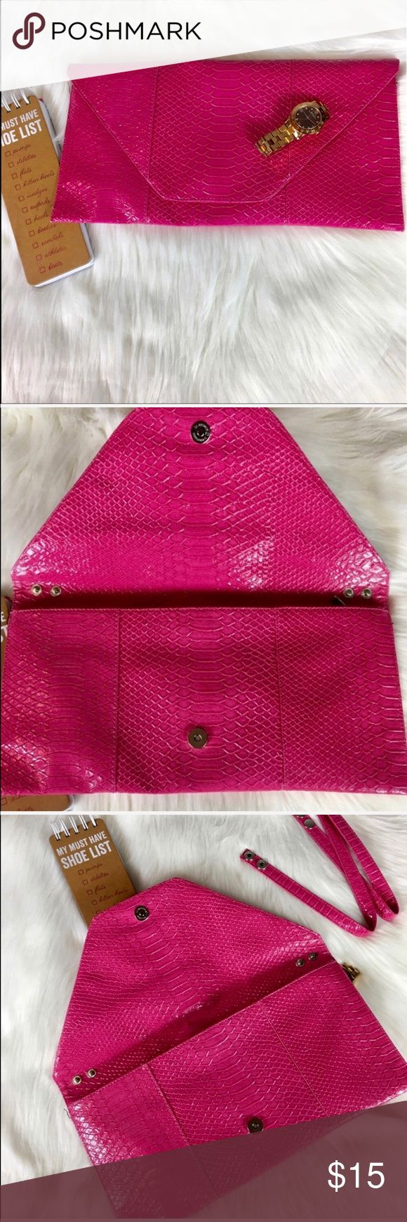 """Pink Python Print Envelope Clutch Beautiful pink croc embossed XL clutch or purse. This bag is so cute and a dope addition to any closet. Comes with a detachable strap. In excellent condition. Dimensions """"7.5h x14""""l Make this ☝🏾️treasure yours today ☺️. Don't be scared to make an offer, you never know unless you try. Bundle multiple items for the best savings. Pay one low price for shipping 🎁!   Thanks for stepping into Coco's Closet 😘 Bags Clutches & Wristlets"""