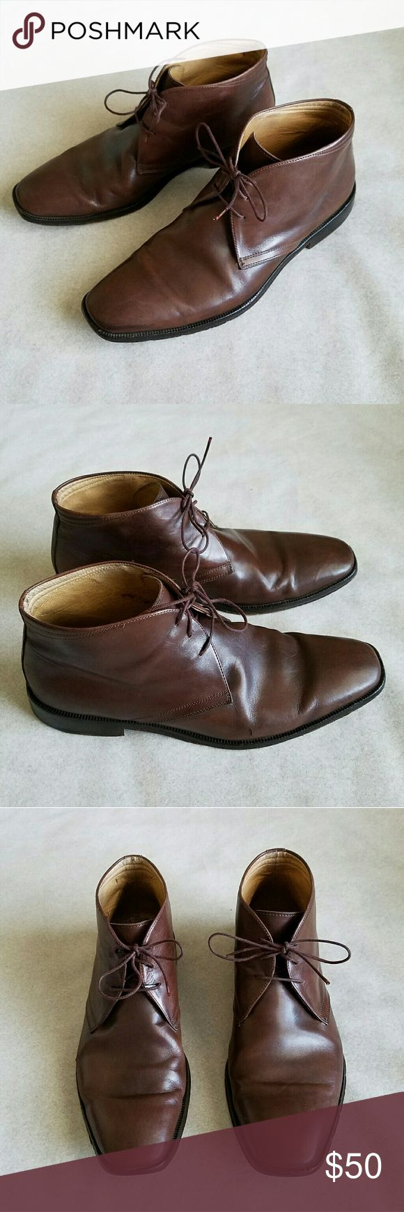 Johnston & Murphy Men's Leather Boots Classic brown leather lace up boots. Men's size 8.5, regular width. Leather is in good condition, right shoe has scratch on outside as shown in 2nd photo. Very good, pre-owned condition. Johnston & Murphy Shoes Boots