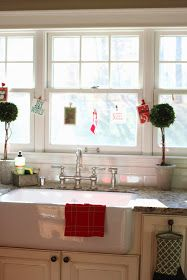 Shaw's Farmhouse sink and Graff bridge faucet with triple windows above sink and preserved boxwood topiaries-www.goldenboysandme.com