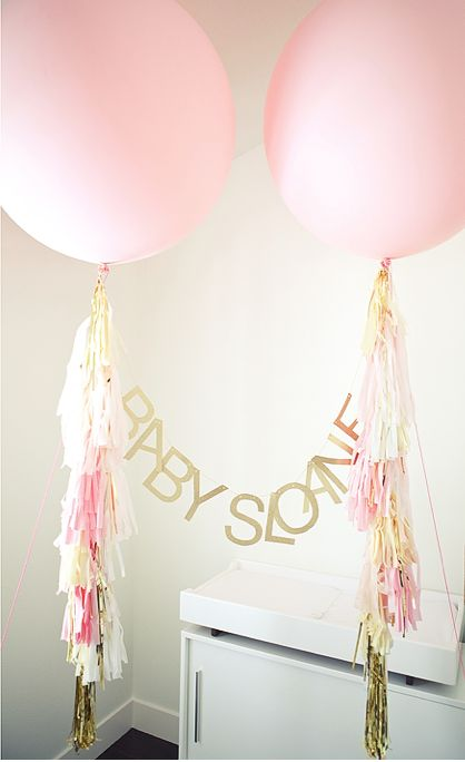 Gold and soft pink big balloon decor for the baby.