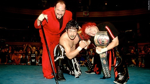 ECW World Tag Team Champions Yoshihiro Tajiri and Mikey Whipwreck with The Sinister Minister
