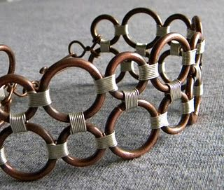bracelet like sculpture - made of copper rings and silver jewelry wire