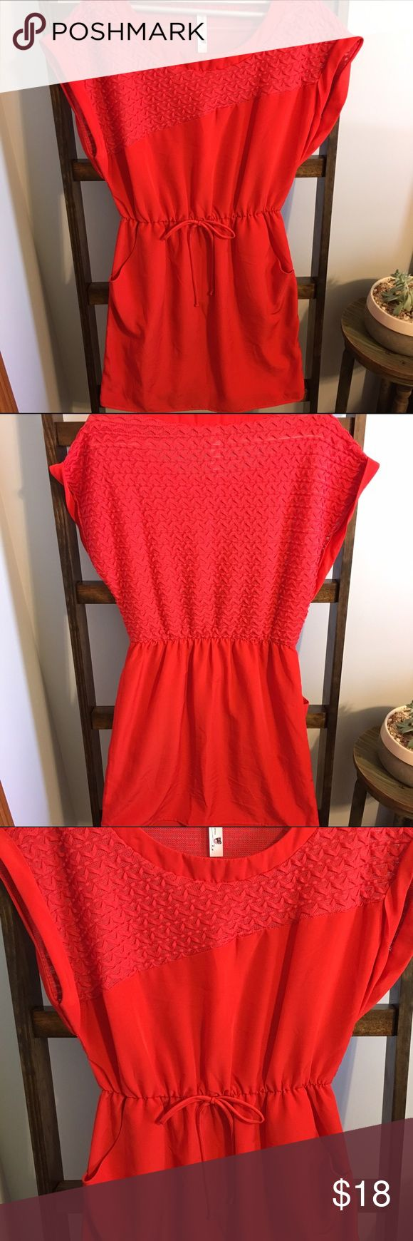 Super adorable red dress! Pink Owl is a Dillard's brand. This super cute dress has pockets and can be dressed up or down. Add a blazer for office wear! The fabric is soft and has a sheen to it. More of a red-orange color. Worn 1 time, no signs of wear. Size Large in juniors so it fits like a Medium. Did I mention that it has pockets???  Pink Owl Dresses Mini