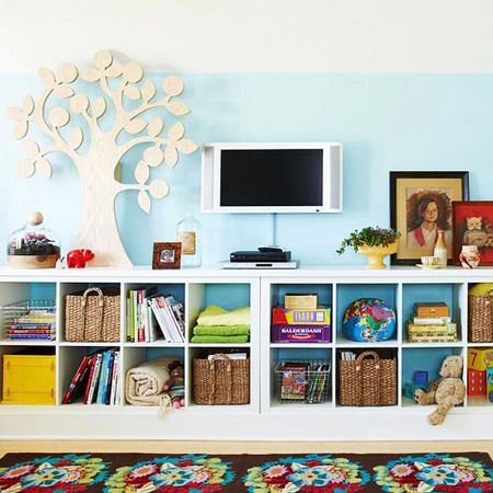 Love this layout for bonus room storage. Ikea shelves on their sides