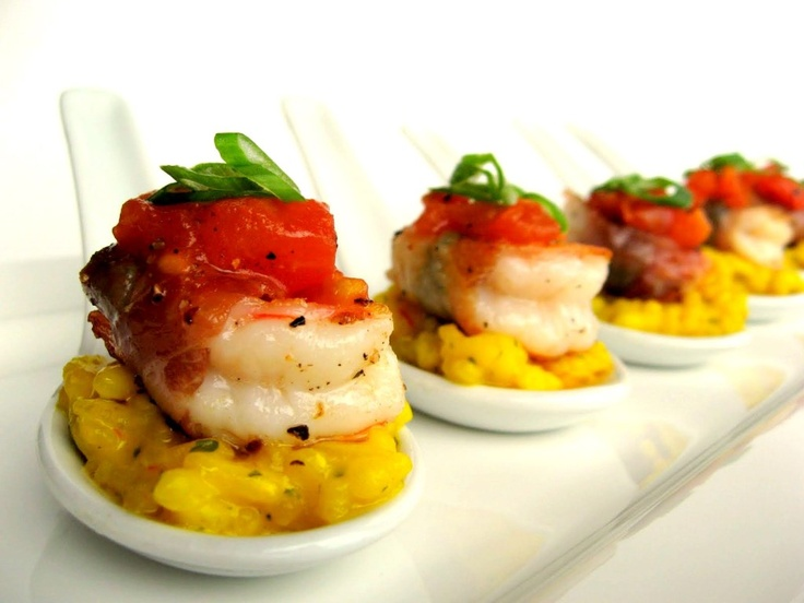 Saffron Rissotto with prosciutto wrapped shrimped topped with stewed tomato