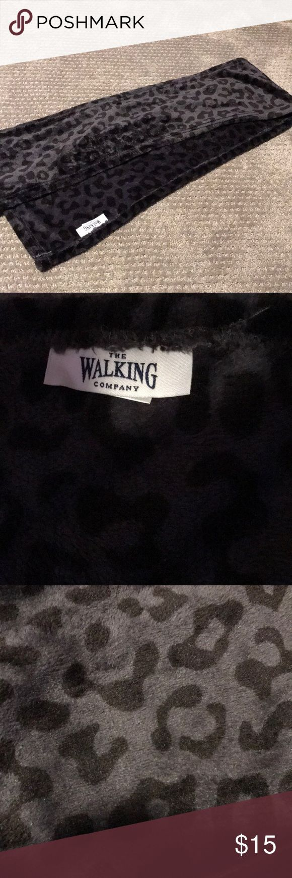 Fuzzy cheetah scarf by the walking company This scarf is SO soft and is very warm! Beautiful and in amazing condition! It is black and grey cheetah the walking company Accessories Scarves & Wraps