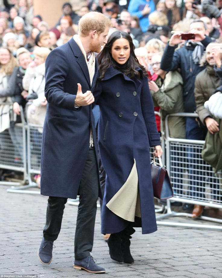 Harry and Miss Markle talk as they arriving in Nottingham this morning on their first ever official royal visit. The prince and the actress immediately undertook a traditional royal walkabout, plunging into the crowds to shake hands and collect bouquets and cards of congratulation.