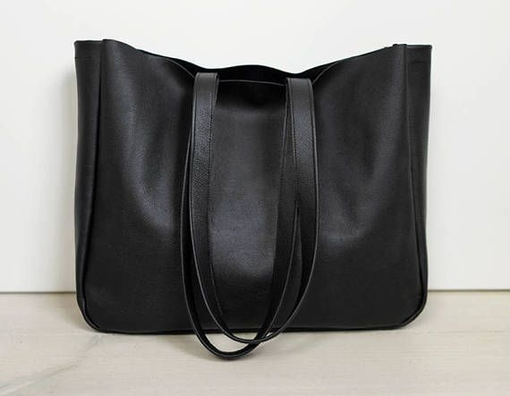 A large minimal bag on shoulder and hand. Made of black genuine, high quality leather. Inside without lining. Close with two snaps in old gold.  Dimensions: Height 32 cm (12,6 ), width 38 cm (15), depth about 11 cm (4,3) shoulder straps 65 cm ( 25,5)   For these bag, please expect 2-3 days for your item to be made and prepared for shipment!  Standard delivery time:  European union: 4 - 10 days  Europe (not EU): 7 - 14 days  U.S.A., Canada: 10 - 20 days  Australia, South America, Asia…