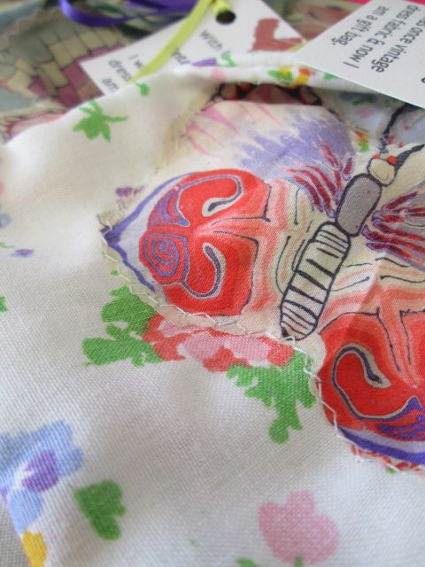 silk butterflies from vintage hankies make super appliques on gift bags.