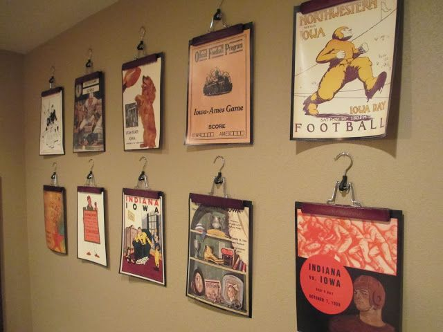 Wooden pant hangers as picture holder. They displayed pics from a good calender. do this in the basement w/KU pics