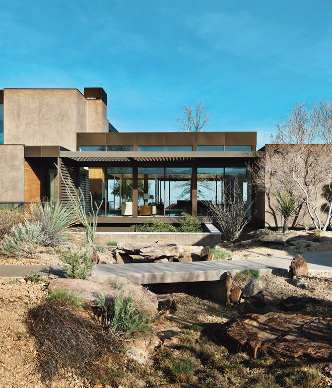A Picturesque Desert Prefab Jim Murren's prefab house in Sin City, designed by Marmol Radziner, is as artful as it is art-filled, thanks to an asymmetrical arrangement of solids and voids. Photo by Jill Paider.