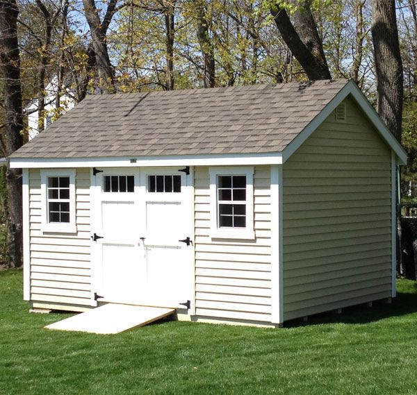 see how simply adding transom windows in your shed doors can transform your storage building this x new england cape shed is a perfect example