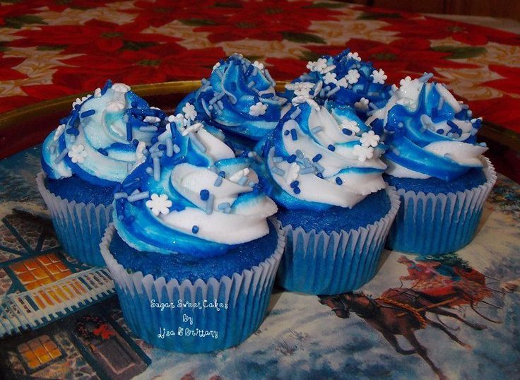 Vanilla cupcakes dyed blue & iced in home made buttercream. Topped with snowflake sprinkles & edible glitter. Photo doesn't do them justice, they are much more sparkly in person. Happy Holidays!! TFL!